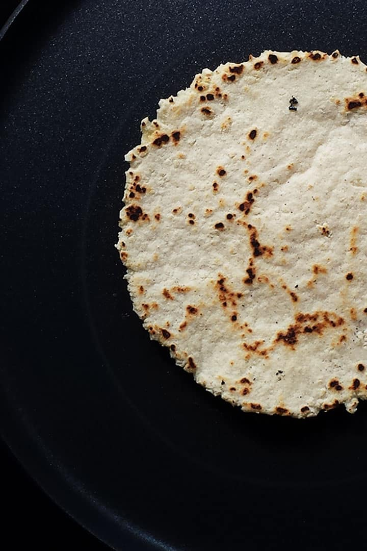 How to make easy corn tortilla recipe with only 3 ingredients masa harissa, salt and water. This homemade corn tortillas recipe is gluten free and vegan. Visit thetortillachanne.com for the full instruction plus video.