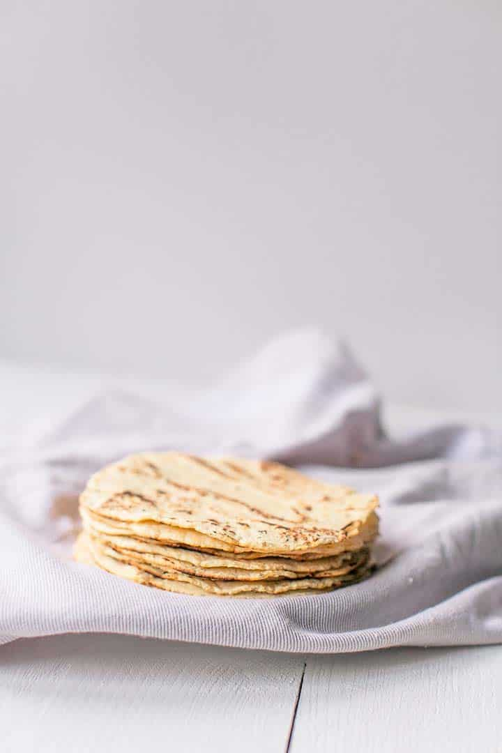 How to make easy corn tortilla recipe with only 3 ingredients masa harina, salt and water. This homemade corn tortillas recipe is gluten-free and vegan. Visit thetortillachanne.com for the full instruction plus video. #corntortillas #homemadetortilla #glutenfreetortilla #easycorntortilla #tortillarecipe