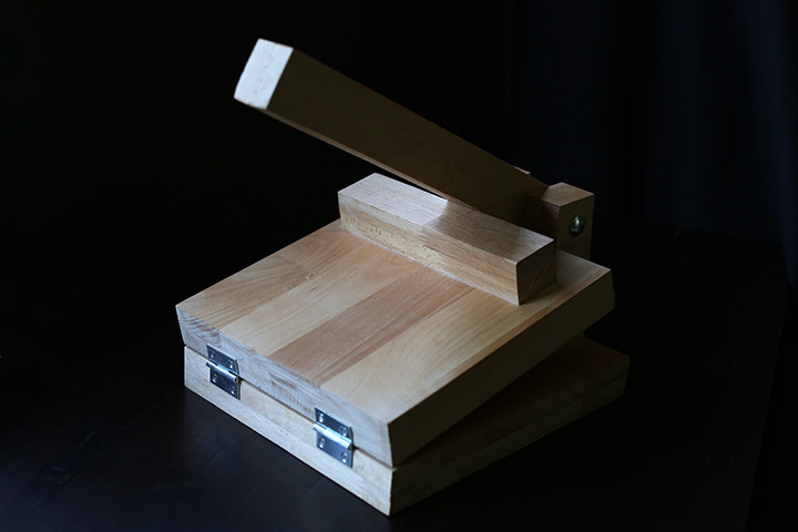 Wooden tortilla press