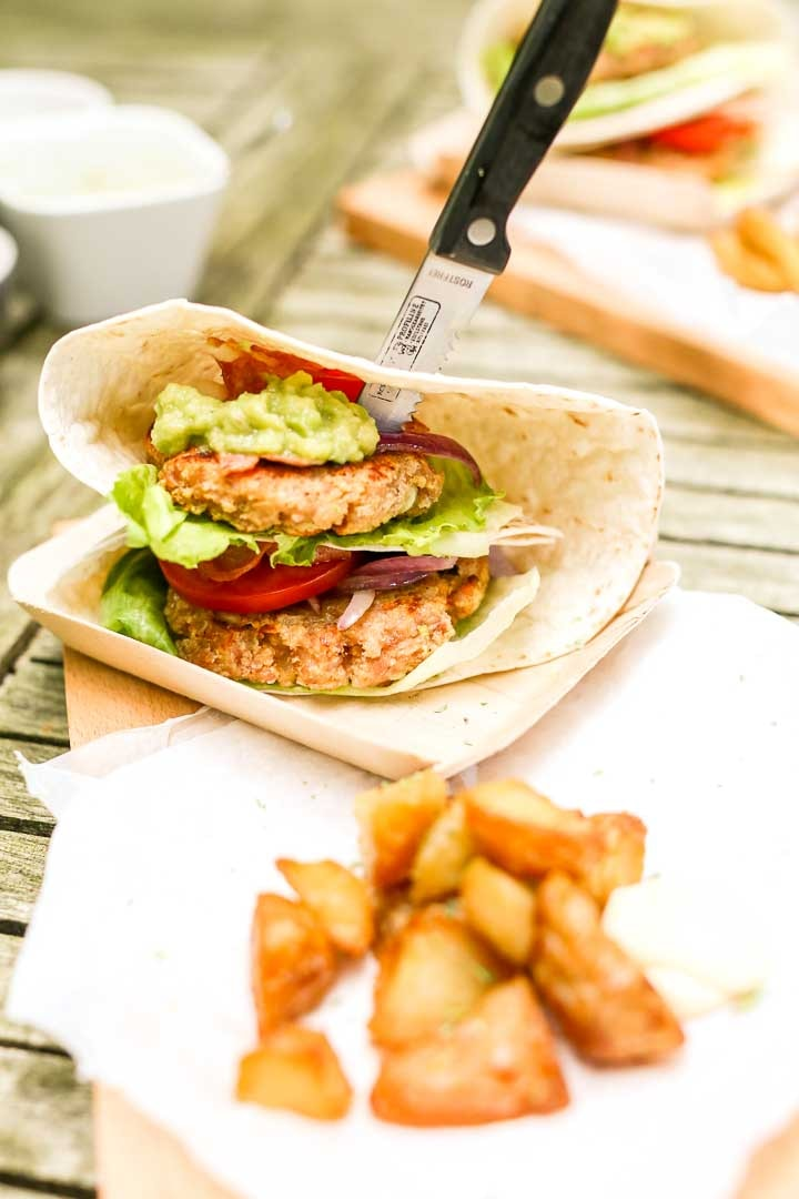 Chicken burgers on the grill wrapped in tortillas with lettuce and guacamole. A great dinner recipe #thetortillachannel #chickenburgers #chickenburger #bbqchickenburger #easyburgers #grilledburgers