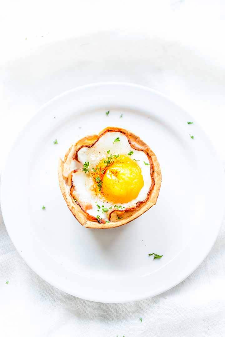 Looking for a great breakfast tortilla recipe? Try these bacon and eggs tortilla cups. They are super delicious and easy to make. Great for breakfast or lunch. Visit thetortillachannel.com for the full recipe and vidoe #thetortillachannel #baconeggscups #easyeggrecipe #baconandeggs #breakfastrecipe #lunchrecipe