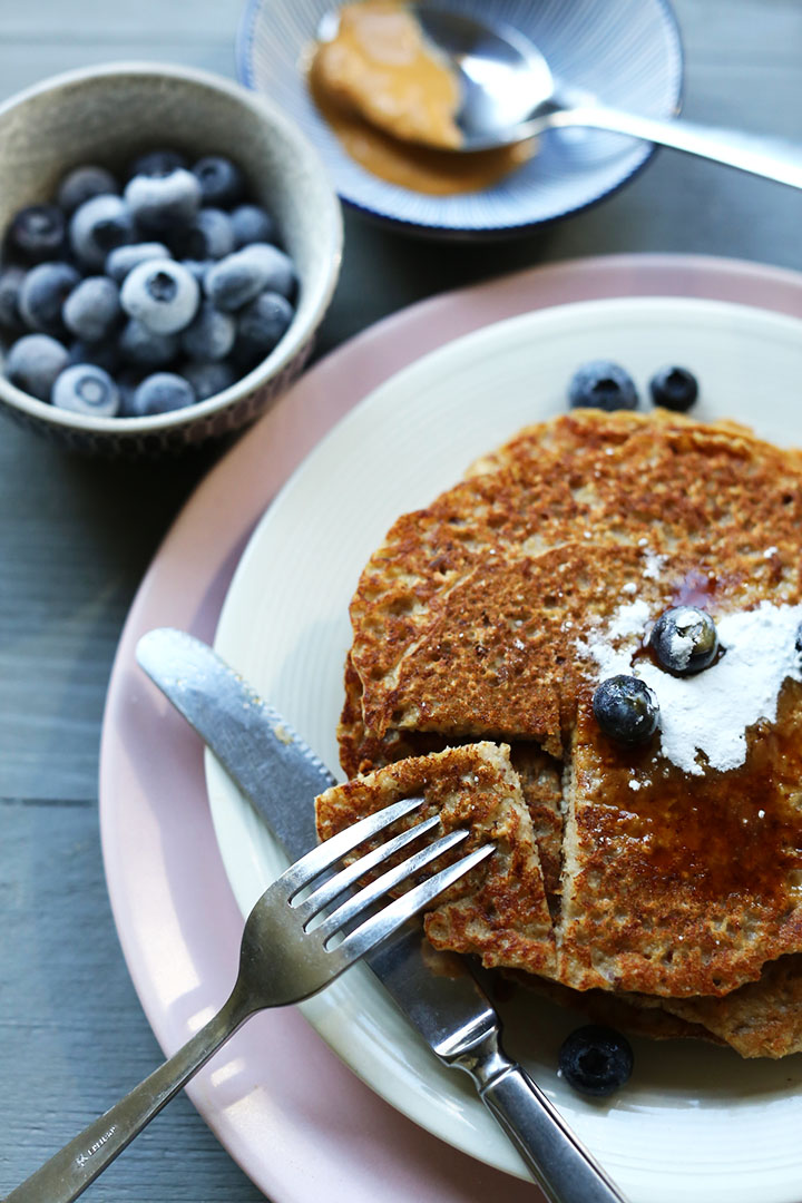 Vegan banana peanut butter pancakes. Want to make this recipe visit thetortillachannel.com #veganpancakes #veganrecipe #easypancakes #glutenfreepancakes