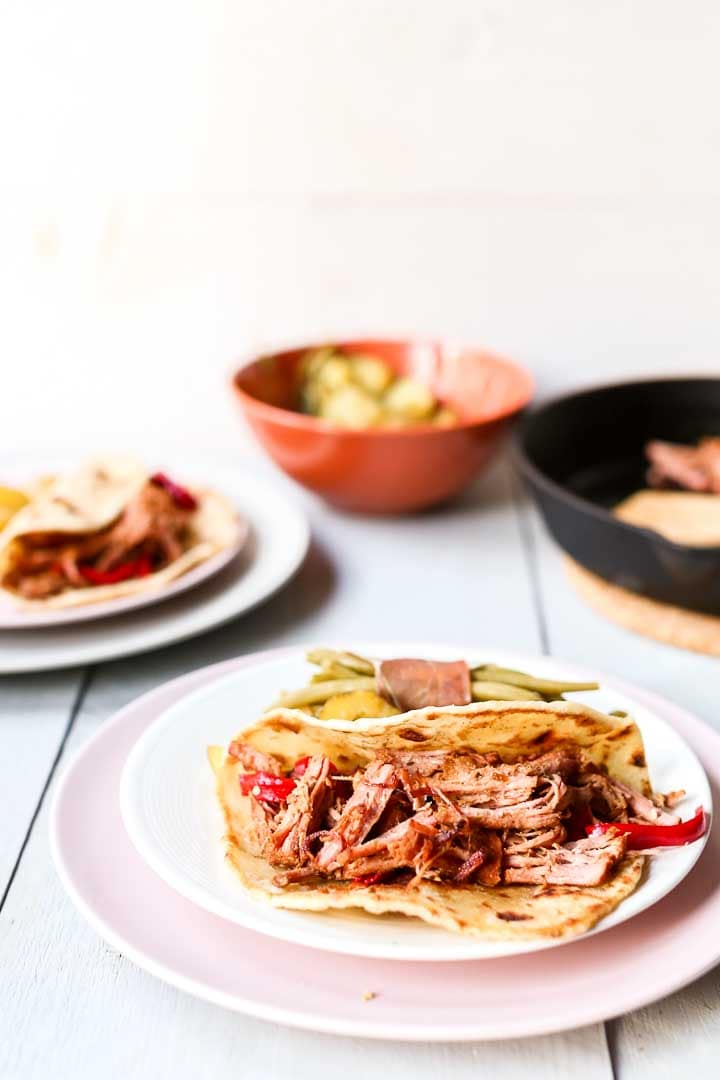 The easiest slow cooked pork carnitas that you can make in Crock pot or oven. Eat with a corn taco or soft tortilla. Visit thetortillachannel.com for the full recipe and video #thetortillachannel #porkcarnitas #dinnerrecipe #carnitas #crockpot #slowcooker