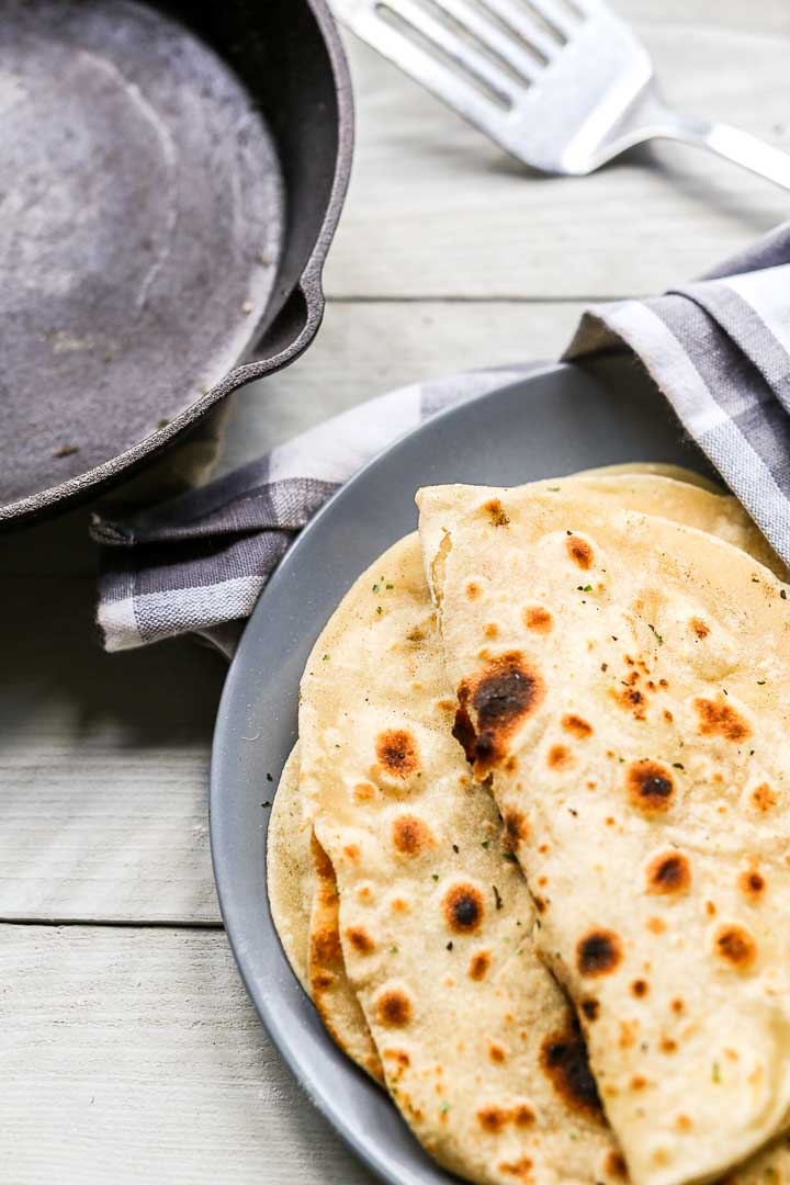 How to make soft vegan flatbread made with non dairy milk. These are pliable, soft and delicious as a side dish for dinner. Visit thetortillachannel.com for the full recipe and video #thetortillachannel #flatbread #veganflatbread #softflatbread