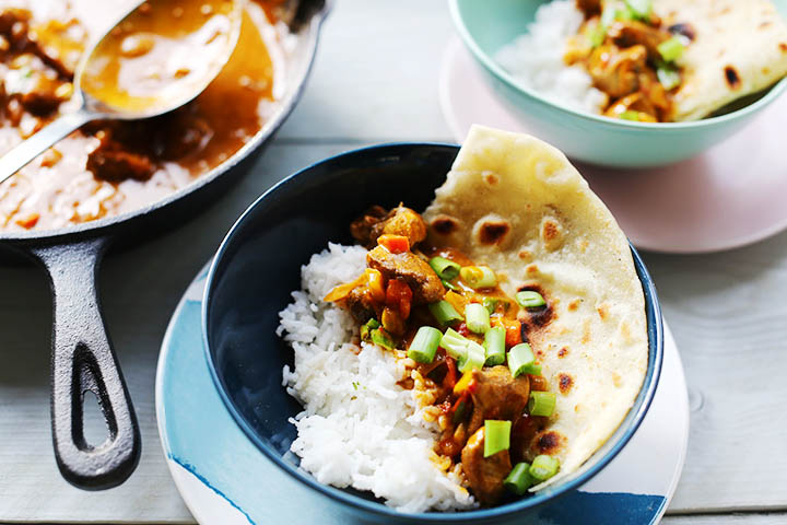 Spicy Thai red chicken curry above