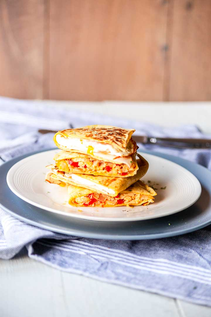 Breakfast egg quesadillas is a super easy quesadilla recipe. Done in no time and great for breakfast, lunch or as a snack. Visit thetortillachannel.com for the full recipe and video #thetortillachannel #eggrecipe #eggquesadilla #breakfastquesadilla