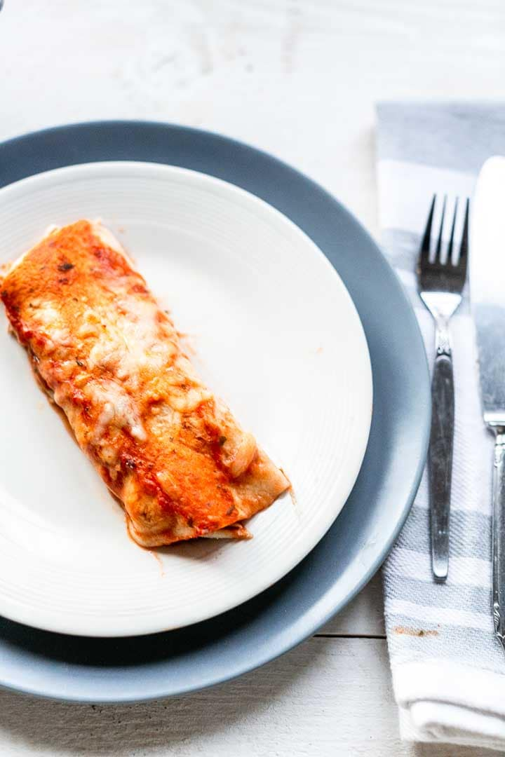 Shredded chicken enchiladas is an easy to make dinner recipe. Done in no time and so tasty. Visit thetortillachannel.com for the full recipe and video #thetortillachannel #enchiladas #chickenenchilada #shreddedchickenenchiladas #enchiladarecipe