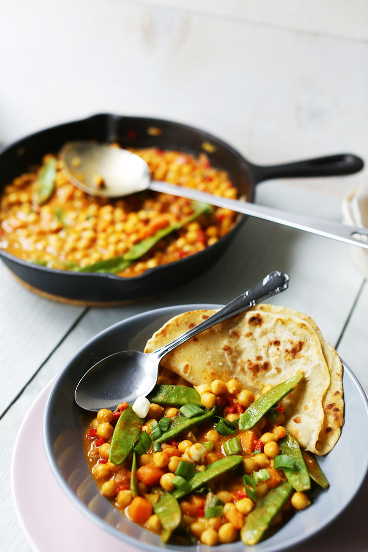 Yummy yellow chickpea curry portrait left