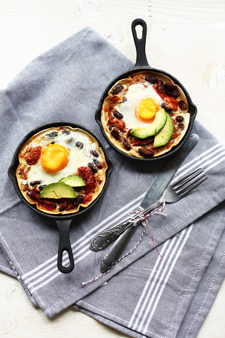 Easy tortilla huevos rancheros two skillets portrait overhead