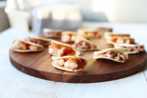 Mini party tacos shrimp on a board side