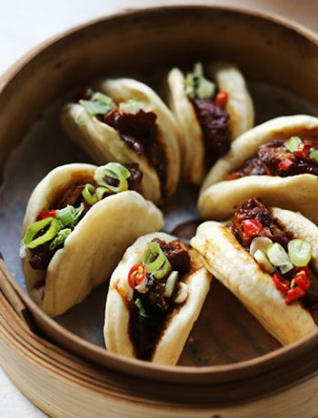 Spicy soy pork with steamed buns in steamer