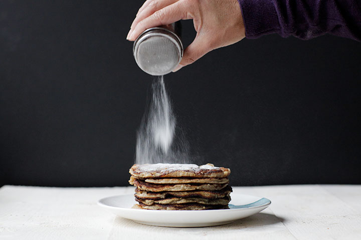 Fluffy banana coconut pancakes with icing sugar