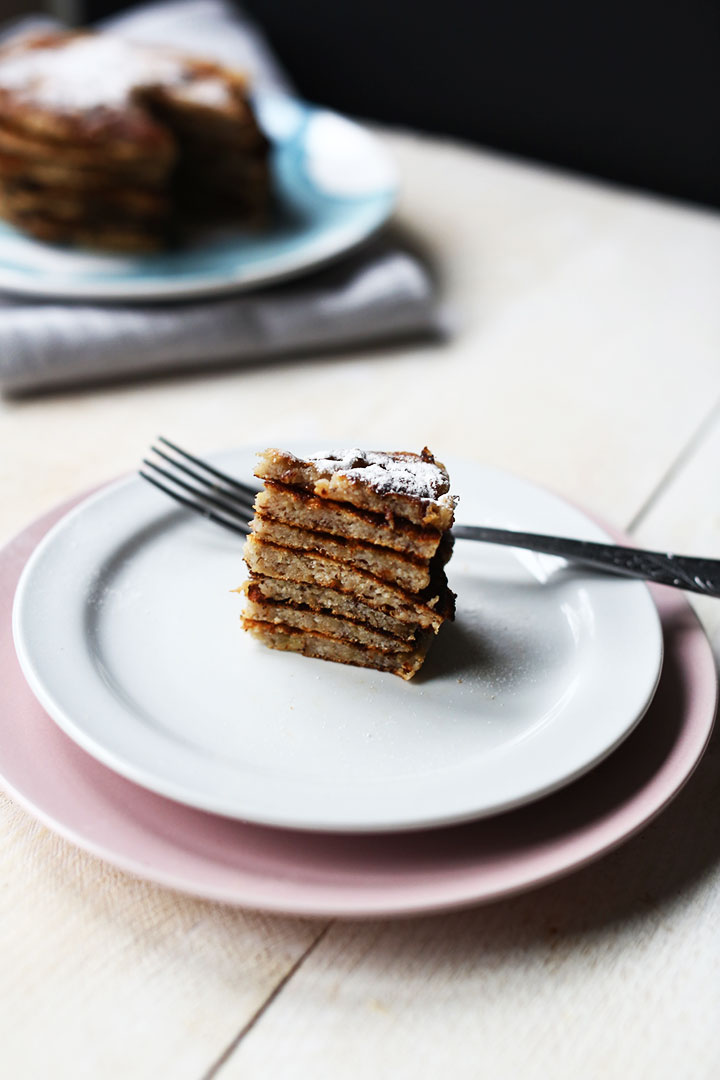 Fluffy banana coconut stacked pancakes wedge with icing sugar