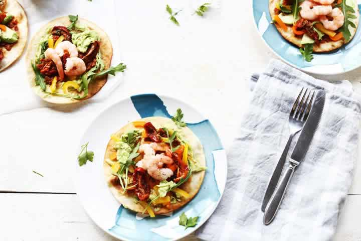 Avocado shrimp tostada. Healthy fish tostada a lunchtime favorite. Visit the website