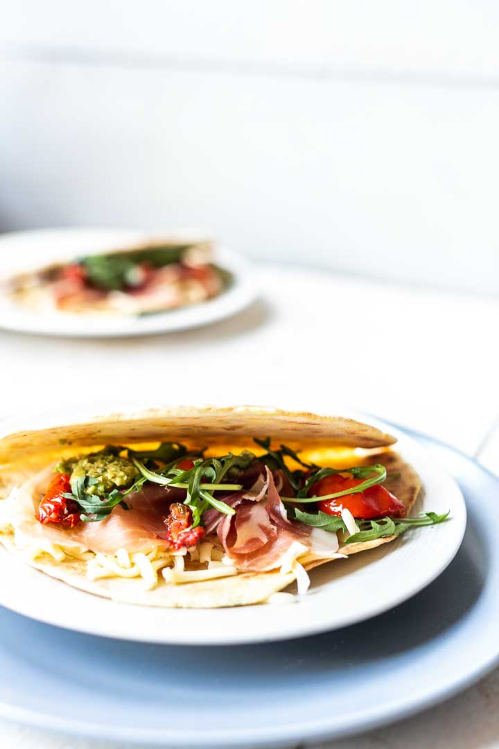 Looking how to make Italian piadina flatbread at home? This recipe will show you how easy you can make this Italian tortilla. Decorate with your favorite toppings. Visit thetortillachannel.com for the full recipe and video #thetortillachannel #piadina #italianpiadina #italianflatbread #flatbreadrecipe #lunch