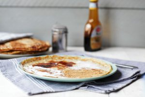 Traditional Dutch pancakes thin and delicious with icing sugar, syrup, sugar. Visit the website or pin it now.