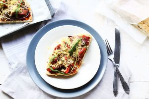 Turkish pide bread pizza recipe on a plate.