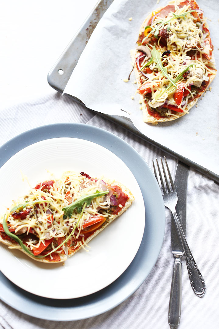 Turkish pide bread pizza on a plate and baking tray