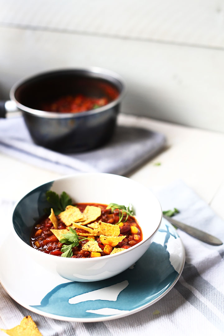 Bean tortilla soup is a vegan recipe that is healthy and easy to make. Visit the website or pin it now.