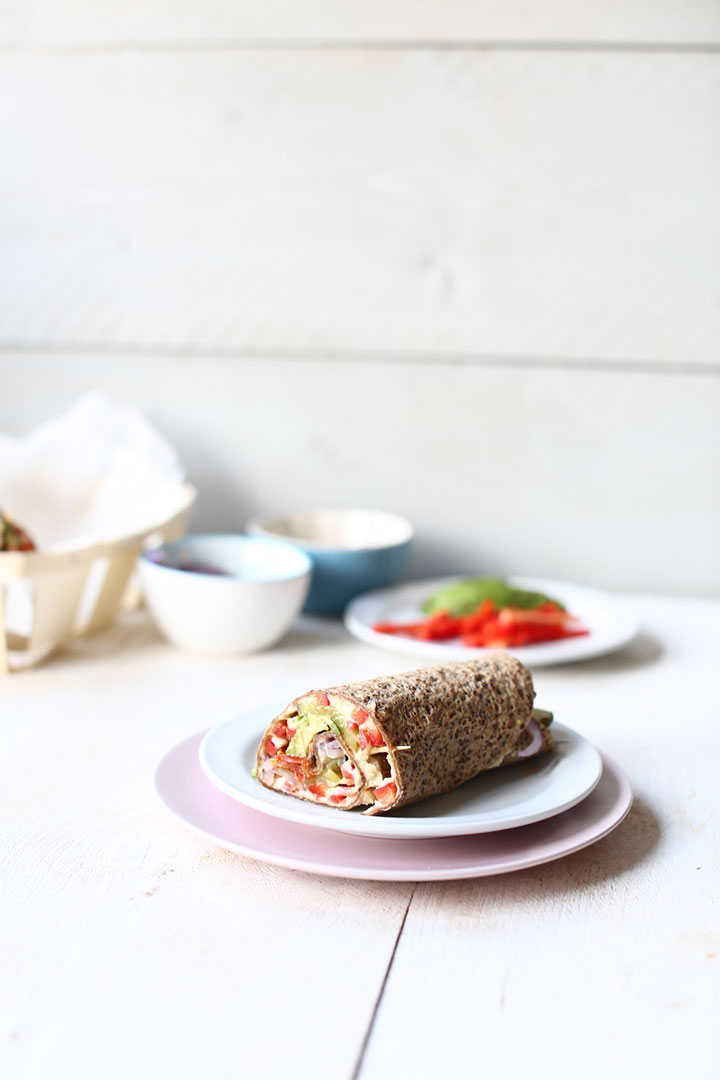 Vegan lunchbox smart wraps with a bite. Wrap on a plate.