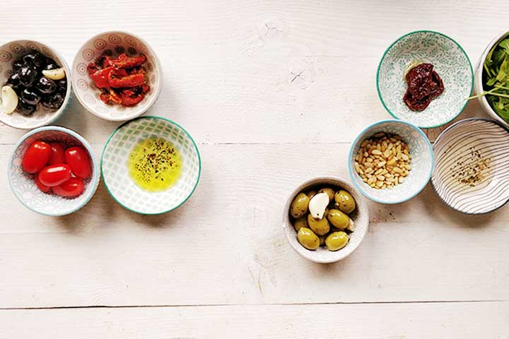 Rustic olive and sun-dried tomato tapenade ingredients. Two delicious tapenades.