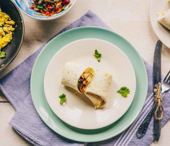The best breakfast burrito is made with scrambled eggs, vegetable mix, bacon and kidney beans. Wrapped in a tortilla this burrito is freezer friendly and easy to make.