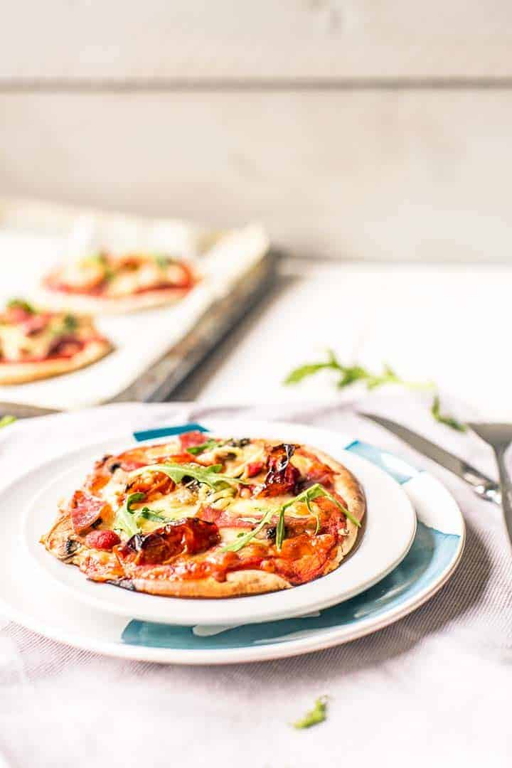 Pita pizza is the easiest pizza recipe with salami and lots of vegetables. Visit thetortillachannel.com for the full instructions #pitabreadrecipe #pitapizza #pitapizzasalami #tastypitapizza