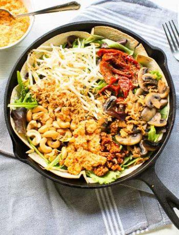 Vegan peanut salsa summer salad in a tortilla bowl. With some Asian flavors. Want to make this recipe visit thetortillachannel.com. #asiansalad #vegansalad #summersalad #peanutsalsa#salad