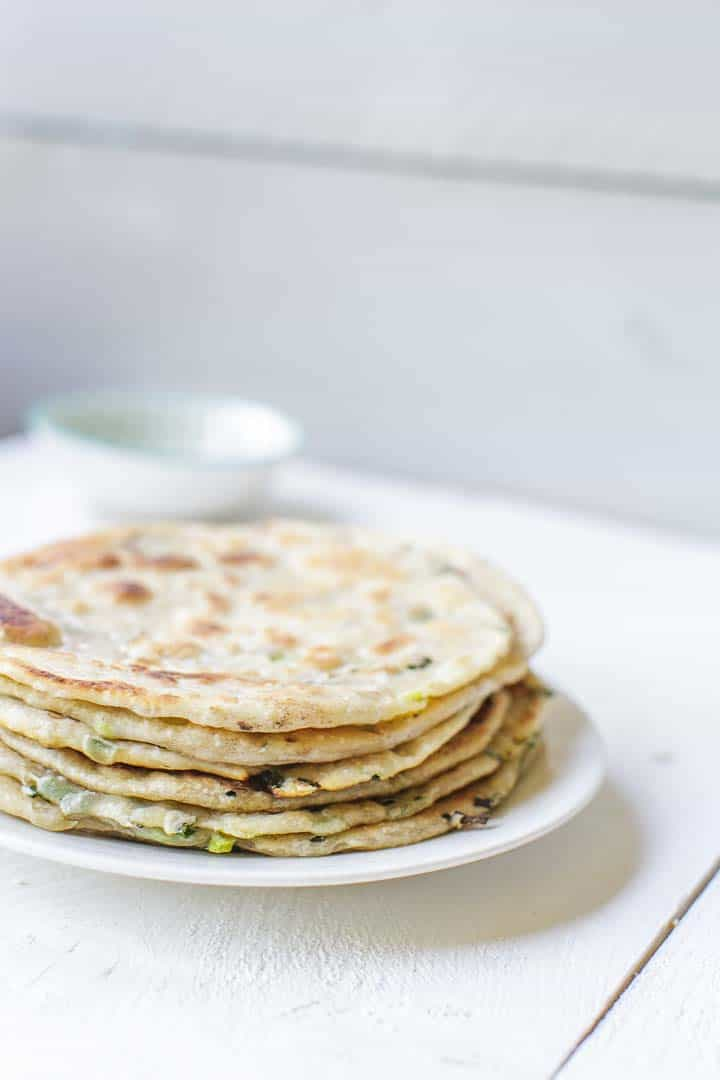 The best Chinese scallion pancakes with just 5 ingredients. A stack of vegan pancakes. Visit thetortillachannel.com #scallionpancake #chinesepancake #chinesescallionpancake #pancake #congyoubing
