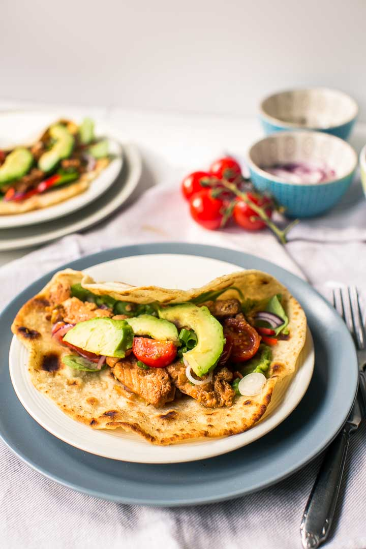 Avocado salmon wraps on the go but also great for a weeknight dinner or lunch. Made with fresh ingredients and home made tortilla. Want to make this recipe visit thetortillachannel.com #wraps #salmonwrap #lunchwrap #dinnerwrap #yufkawrap #avocadosalmonwrap