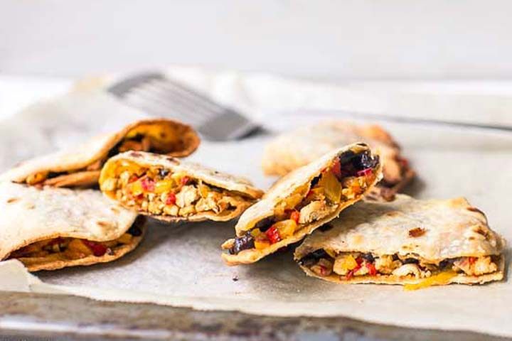 Chicken quesadillas are a low calorie recipe and is super easy to make. Great for dinner or lunch. Visit thetortillachannel.com for the recipe and video #thetortillachannel #chickenquesadillas #easychickenquesadillas #quesadillas #ovenbakedquesadillas #bakedquesadillas