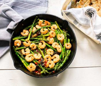Garlic shrimp asparagus tacos in a skillet. Great for taco tuesday. Want to make this recipe visit thetortillachannel.com #tacos #asparagas #shrimp #shrimptacos #tacotuesday #shrimpasparagusskillet #castironskillet #easytaco