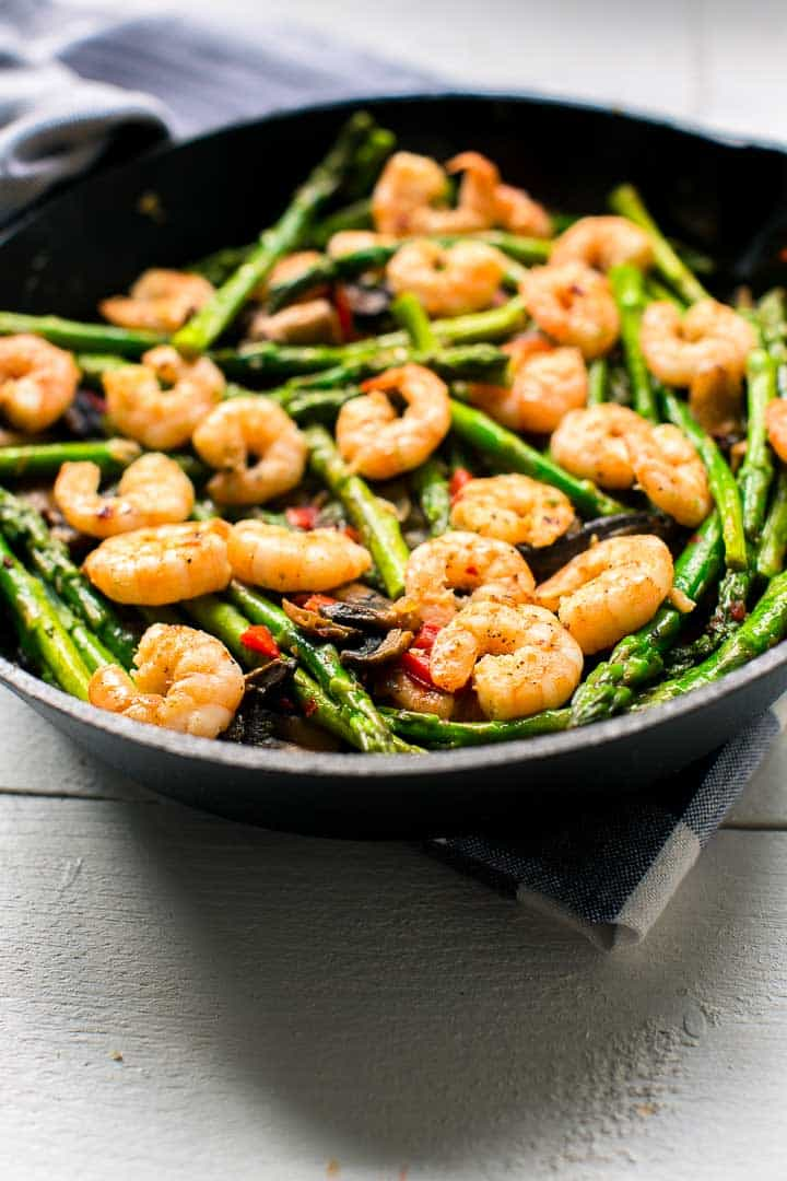 Cast iron skillet garlic shrimp asparagus tacos. Great for taco tuesday. Want to make this recipe visit thetortillachannel.com #tacos #asparagas #shrimp #shrimptacos #tacotuesday #shrimpasparagusskillet #castironskillet #easytaco