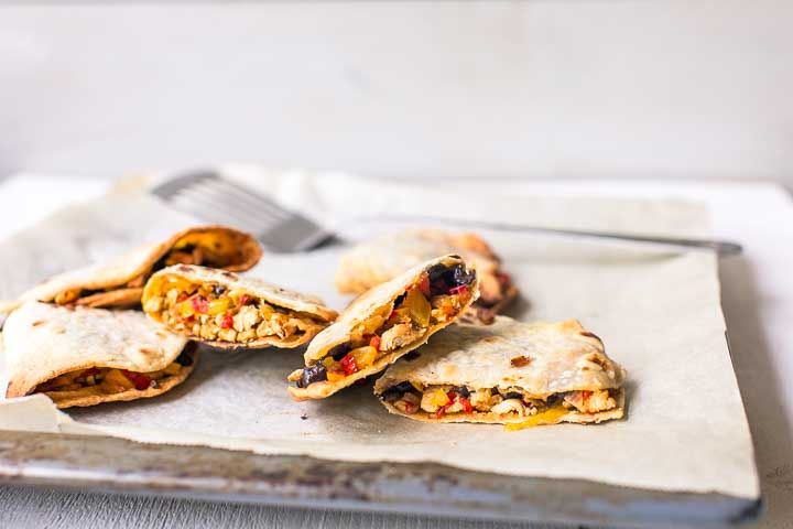 Super simple oven baked chicken quesadillas are easy to make, low fat and delicious. Great lunch recipe. Want to make this recipe visit thetortillachannel.com #quesadilla #quesadillas #chickenquesadillas #ovenbakedquesadillas
