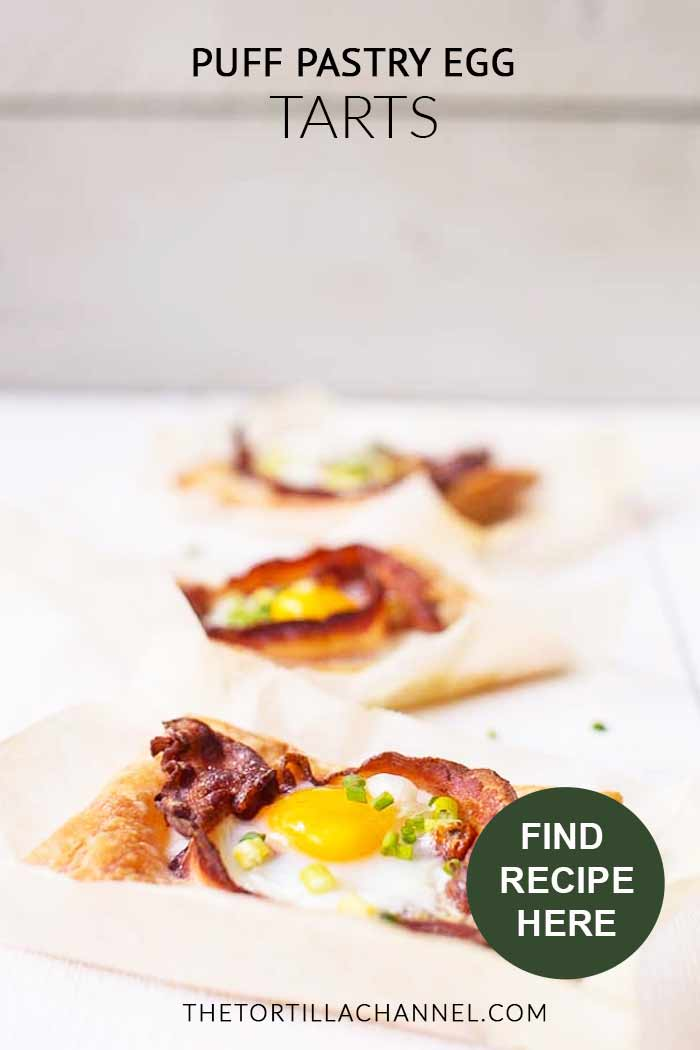 The most amazing puff pastry egg tarts in the world with bacon, sun dried tomatoes and eggs. Ready in just 20 minutes with lots of options. Want to make this breakfast or lunch recipe visit thetortillachannel.com #baconandeggs #puffpastry #puffpastryeggtarts #eggtarts #breakfasteggtarts