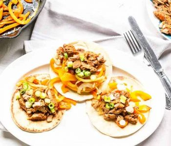 Looking for a great pulled pork fajita recipe? Try this pork fajitas recipe made with pork shoulder in the slow cooker. Set and forget a great Mexican dinner recipe. Visit thetortillachannel.com for the full recipe and video #thetortillachannel #fajitas #fajita #porkfajitas #pulledporkfajita