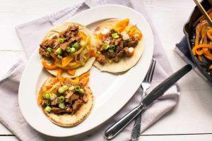 The best pork shoulder fajitas recipe with soft tortilla. Want to make this recipe visit thetortillachannel.com #fajitas #pulledporkfajitas #shreddedporkfajitas