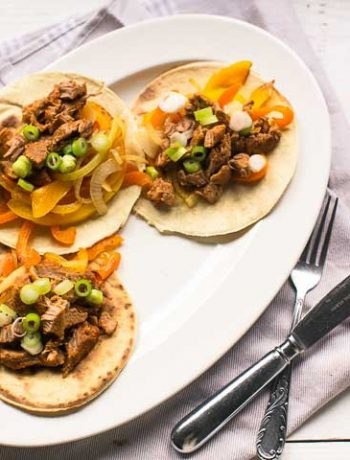 The best pork shoulder fajitas recipe with soft tortilla. Want to make this recipe visit thetortillachannel.com #fajitas #pulledporkfajitas #shreddedporkfajitas