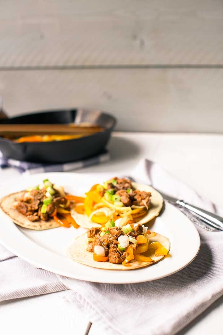 Delicious pork shoulder fajitas recipe with soft tortilla. Want to make this recipe visit thetortillachannel.com #fajitas #pulledporkfajitas #shreddedporkfajitas