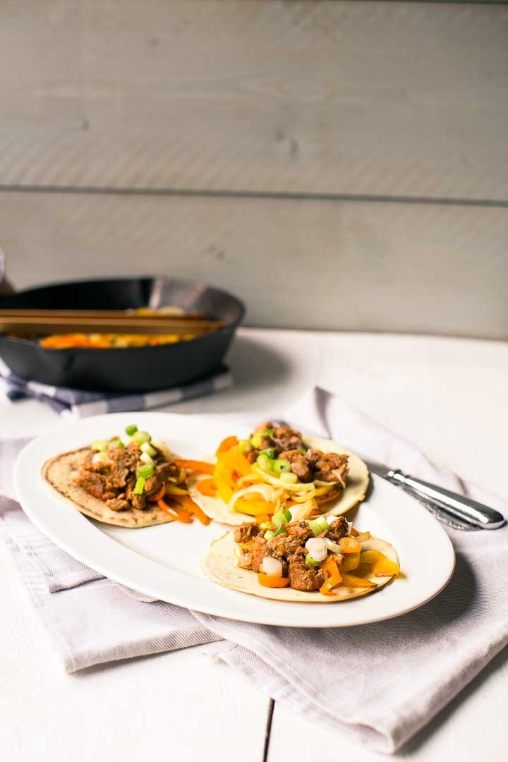 Pork shoulder fajitas recipe with soft tortilla. Want to make this recipe visit thetortillachannel.com #fajitas #pulledporkfajitas #shreddedporkfajitas