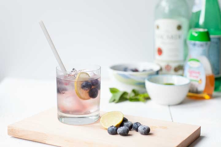 The perfect blueberry mojito cocktail. A great summer drink with bacardi rum, lime, blueberries. Want to make this recipe visit thetortillachannel.com #cocktail #mojitococktail #blueberrymojito #blueberrycocktail