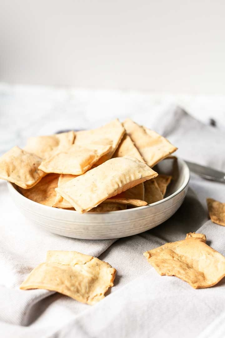 Homemade crackers with rosemary sea salt are made with flatbread. Done in no time want to see how you can make them to visit thetortillachannel.com #homemadecrackers #vegancrackers #rosemaryseasaltcracker #flatbreadcrackers