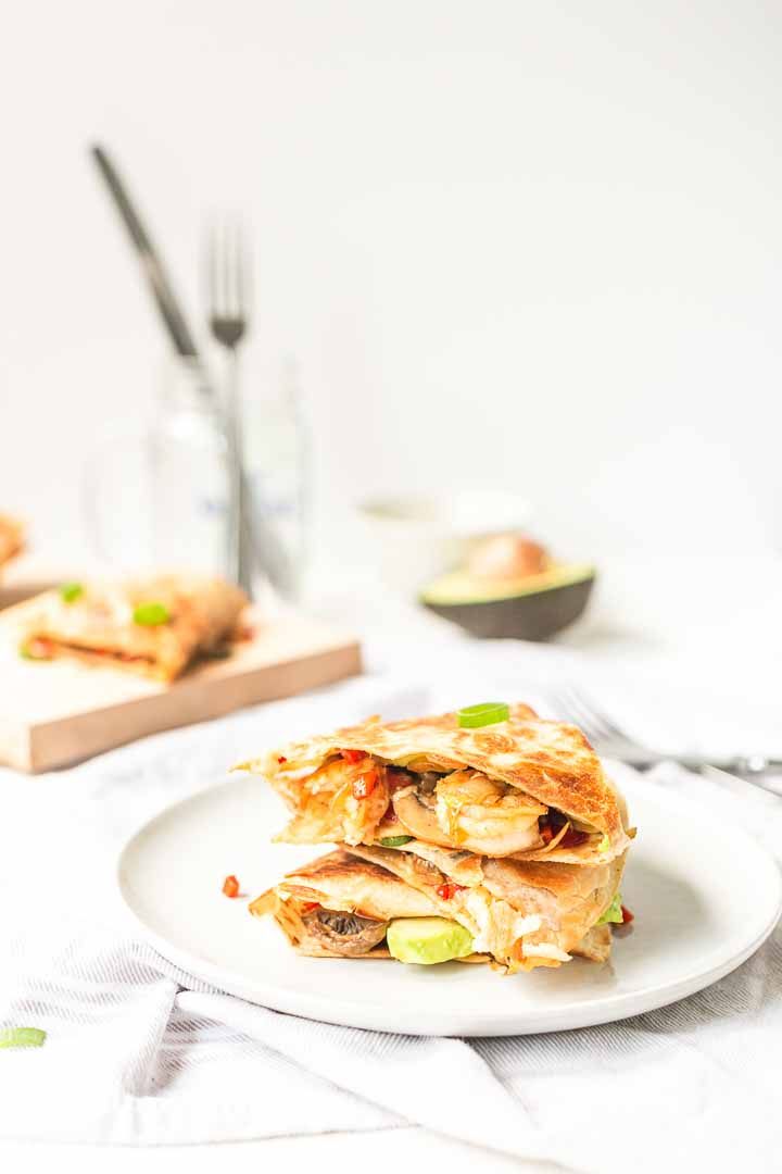 Looking for a delicious quesadilla recipe? Take a look at these shrimp quesadillas with avocado. These are pan fried but you can also make them as oven-baked quesadillas. Visit thetortillachannel.com for the full recipe #thetortillachannel #shrimpquesadillas #quesadillas #shrimpquesadillarecipe #shrimpquesadillawithavocado