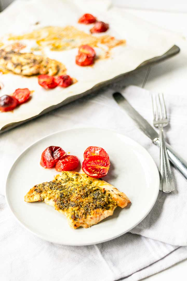 If you love chicken for dinner then this recipe is for you. Juicy chicken pesto is great with tomatoes and is lowcarb friendly. #lowcarb #thetortillachannel #chickenpesto #ovenbakedchicken #chickenrecipe