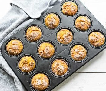 Fall baking with these pumpkin muffins. An easy how to make pumpkin muffin recipe with a pecan, sugar and pumpkin pie spice topping. Visit thetortillachannel.com for healthy pumpkin muffins #pumpkinmuffins #pumpkinpiemuffinrecipe #pumpkinpiemuffin #muffins #pumpkinrecipes #thetortillachannel
