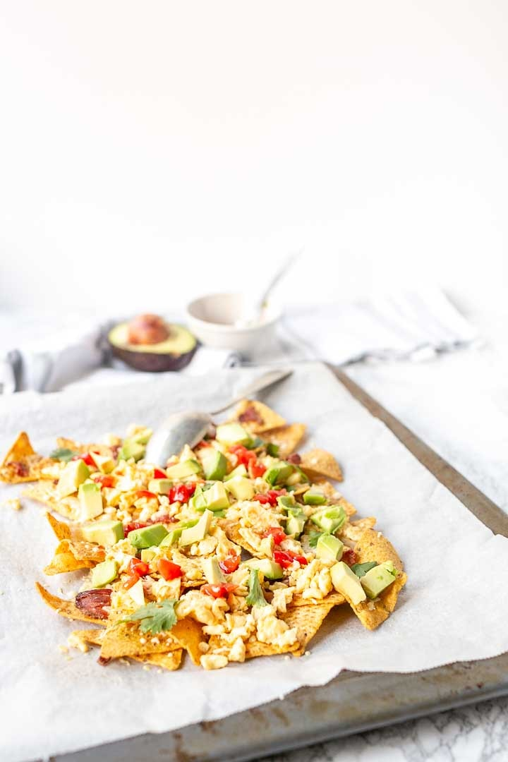 Breakfast nachos are great for breakfast, lunch or brunch. A new kind of bacon and egg recipe so now every day can be national nacho day #thetortillachannel #breakfastnachos #baconandeggnachos #nationalnachosday #easynachos