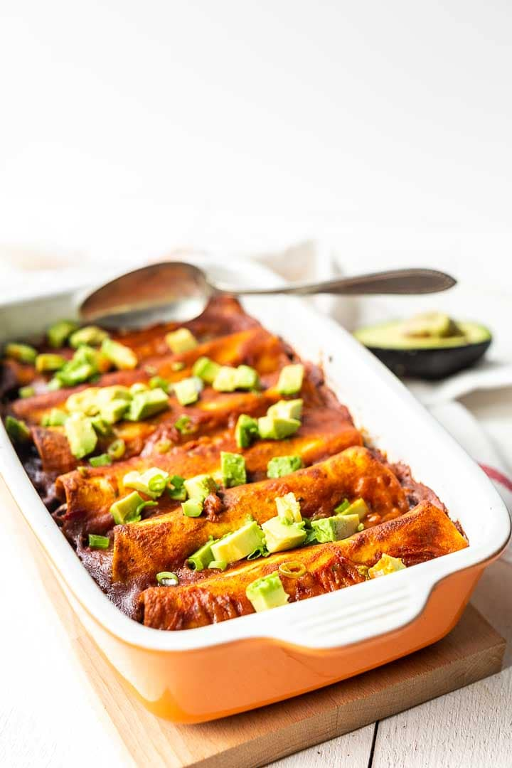 Vegan enchiladas made with lots of vegetables and homemade enchilada sauce. Visit thetortillachannel.com #thetortillachannel #veganenchilada #veganenchiladas #enchiladas #enchilada #easyenchiladas