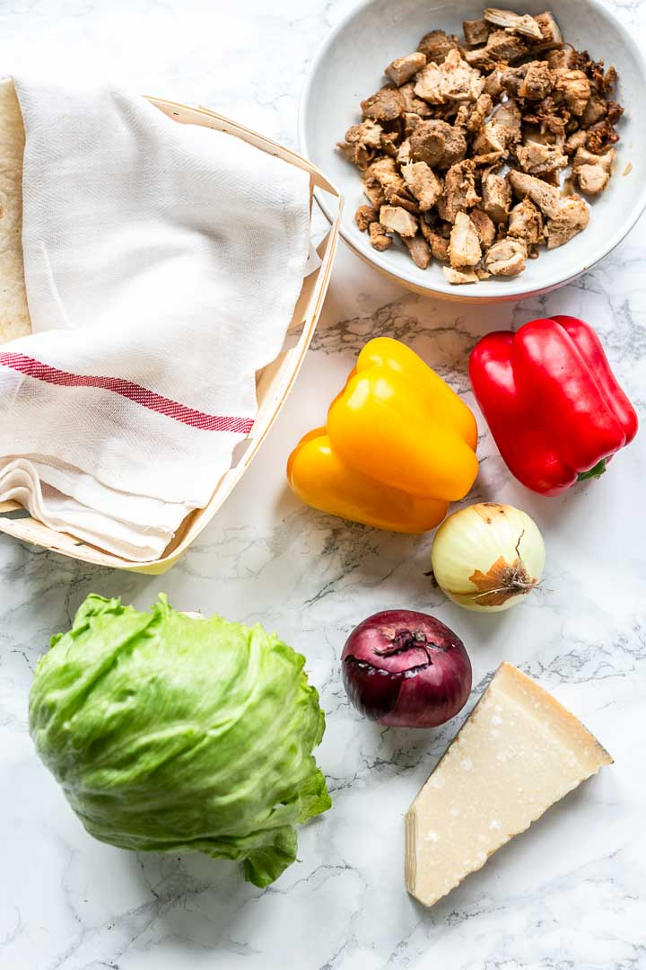 How to make a chicken wrap. This recipe is made with Mexican chicken, lettuce, bell pepper and more. Great lunch wrap or dinner wrap. Visit thetortillachannel.com for the full recipe. #thetortillachannel #chickenwrap #Mexicanchickenwrap #wrap #tortilla #lunchwrap #dinnerwrap #tortillas