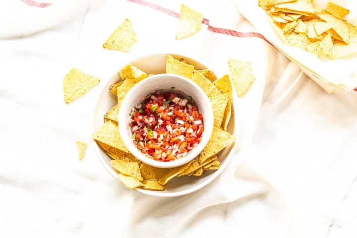 Pico de gallo a Mexican salsa that is also know as salsa Mexicana, salsa fresca or salsa cruda. It is fresh a bit chuncky and tasty. Great with tortilla chips or on your tacos. Visit thetortillachannel.com for the full recipe. #thetortillachannel #picodegallo #salsamexicana #salsafresca #salsacruda