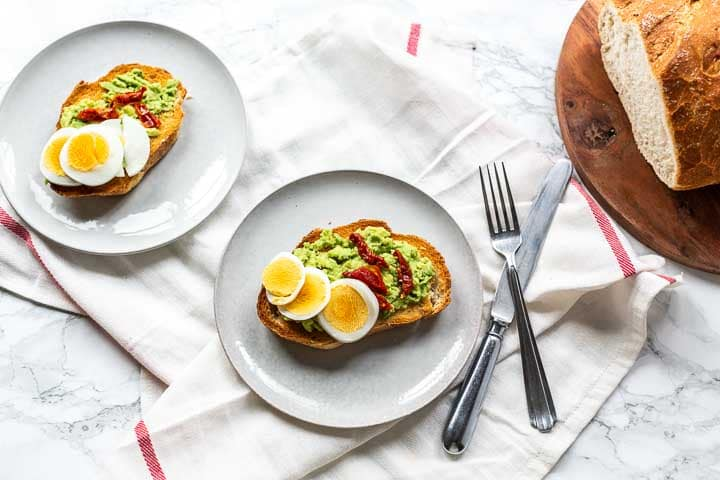 Simple avocado toast with creamy avocado butter and eggs is a great lunch recipe. Visit thetortillachannel.com for the full recipe #tortillachannnel #avocado #avocadotoast #toast